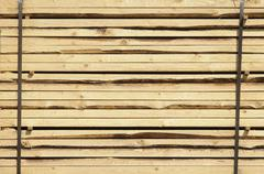 Stacked boards fastened with steel strips, construction timber Stock Photos