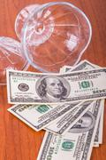 Stock Photo of dollar banknotes out of glass bowl