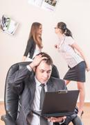 Businessman works with laptop and is distressed Stock Photos