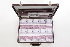 briefcase full of banknotes - stock photo