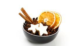 star anise with cinnamon stars, cinnamon sticks and dried orange slices - stock photo