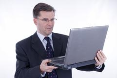 Businessman, 50+, with a laptop Stock Photos