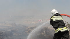 Fire brigade extinguishes the fire Stock Footage
