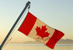 canadian flag on a ship in morning light, british columbia, canada, north ame - stock photo