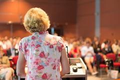 Female academic professor lecturing. Kuvituskuvat