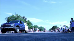 Local high school drill team in parade during small town summer festival Stock Footage