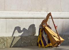 Street musician in front of the cathedral in the inner city of salzburg, aust Stock Photos