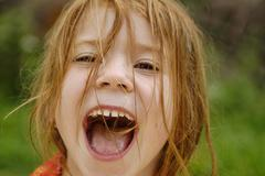 Little girl cries shouts screams very loud Stock Photos