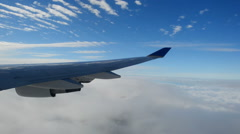 Time Lapse of Clouds Outside of Jet Window - stock footage
