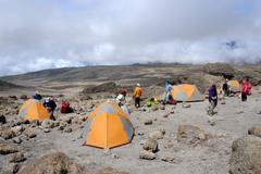 Group of trekkers with tents at school hut camp kikelewa route kilimanjaro ta Stock Photos