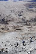 Group of mountaineers at dusty descent to kibo hut marangu route kilimanjaro  Stock Photos