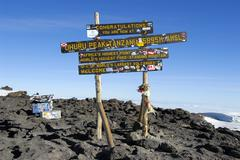 Sign on the summit uhuru peak (5895 m) crater rim kilimanjaro tanzania Stock Photos