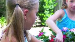 Little girls planting flowers 4k Stock Footage