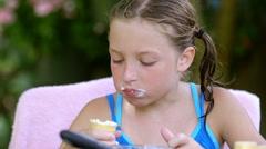 Little girl eating ice cream Stock Footage