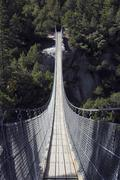 Suspension bridge made of steel cable, handegg, grimsel pass, canton of uri,  Stock Photos