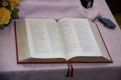 Open bible on a altar Stock Photos