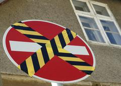 taped over one-way street sign - stock photo