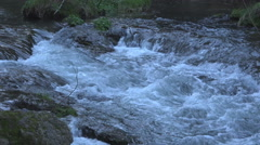 water in stream converges  4k - stock footage
