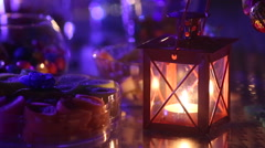 Candle burning near a variety of sweets Stock Footage