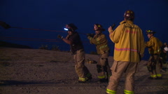 Stock Video Footage of Firefighters attempt a night time Cliff Rescue and pull a rope together