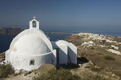 Stock Photo of chapel agios vassilios with view onto oia, santorini, cyclades, aegean sea, g