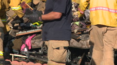 Firefighters remove burned belongings from a garage fire Stock Footage