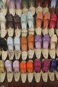 u.a.e., dubai, display of colourful slippers, textile souk - stock photo