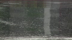 Heavy rain downpour hitting the street Stock Footage