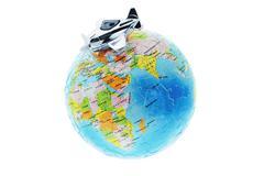 miniature toy aircraft on globe - stock photo
