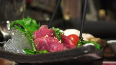 Stock Video Footage of Chopsticks Pick Up An Sashimi (Most Likely Horse Meat) 02 4K