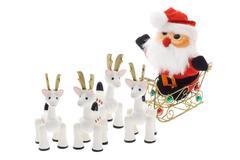 Santa riding on sledge Stock Photos