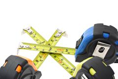 Measuring tapes criss crossing Stock Photos