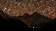 Time lapse of stars behind mountain Kongde Ri Stock Footage