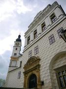 front view of pardubice castle with main gate and clock tower - stock photo
