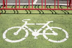 Bicycle-pictogram on the ground Stock Photos
