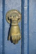 Brazen doorknocker at blue door, oia, santorini, cyclades, aegean sea, greece Stock Photos