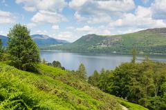 View across Derwent Water to Castlerigg Fell and Bleaberry Fell Lake District uk Stock Photos