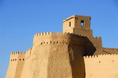 High walls with battlement ko\'xna ark fortress old town khiva uzbekistan Stock Photos