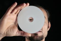 hand holding cd - stock photo