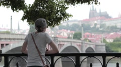 The girl looks at Prague Castle - stock footage