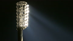 4K FHD Stadium Arena Flood lights lamps shimmering rays of light at night. Stock Footage