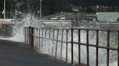 Storm waves crash over barrier Stock Footage
