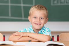 cute little schoolboy with a happy grin - stock photo