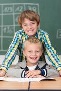 two happy young friends in school - stock photo