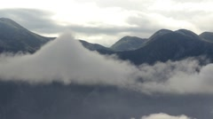 Cloudy sky above rocky mountains. Beautiful mountain landscape. - stock footage