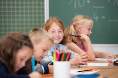 happy young girl in primary school - stock photo