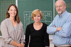group of three school teachers - stock photo