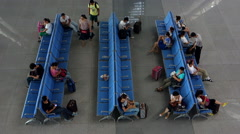 Passengers in waiting hall of a railway station Stock Footage