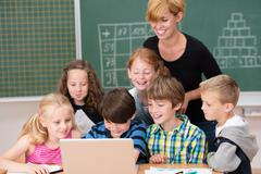 group of small children ion class with a teacher - stock photo