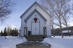 country winter scene of an anglican church decorated for christmas - st. mich - stock photo